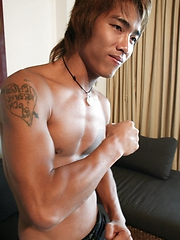 muscular Asian twink posing